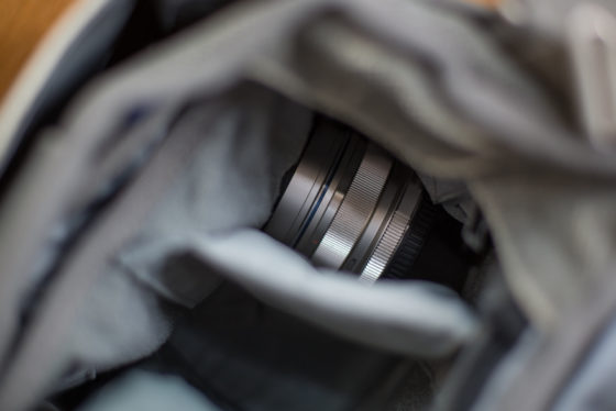 M43 lens stuck in bottom of pouch